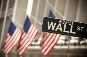 iStock U.S. Flags and Wall Street Sign