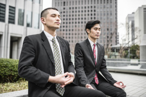 Two asian business men yoga