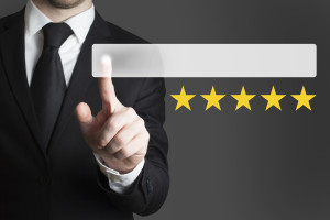 businessman pushing button five rating stars